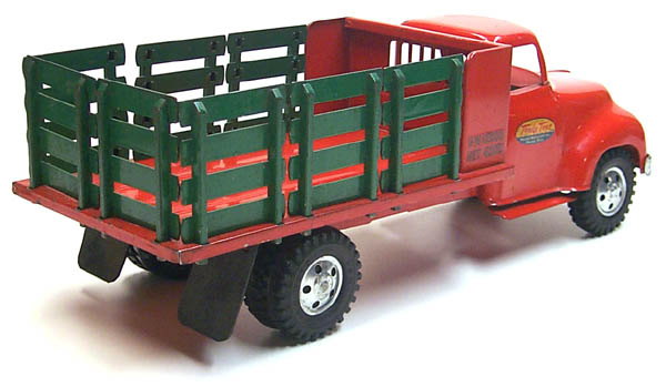 rear view of a 1955 Tonka Lumber Stake Truck Number 0860-5 with racks